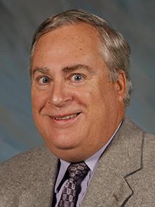 James W. Dennis, M.D.